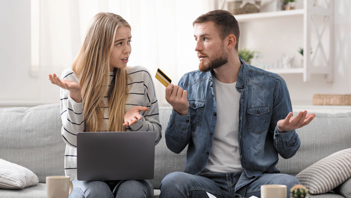 A couple struggling to pay their mortgage